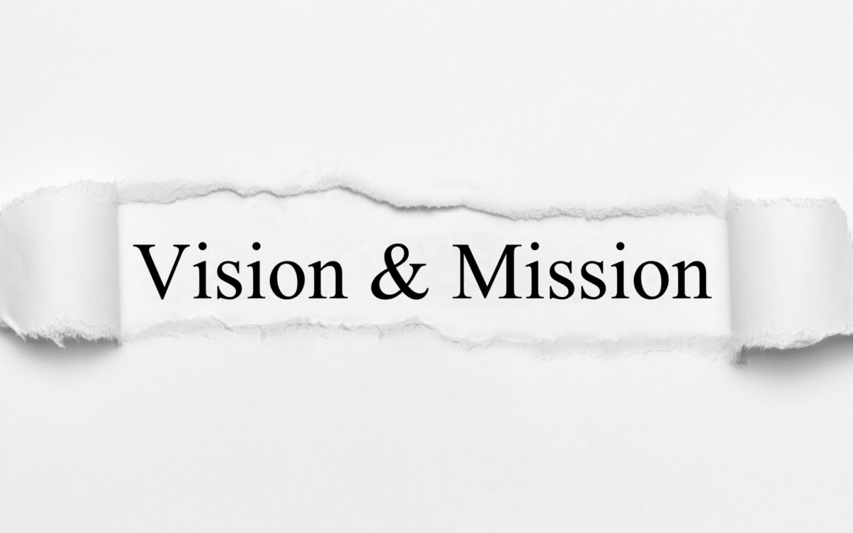 Vision & Mission on white torn paper